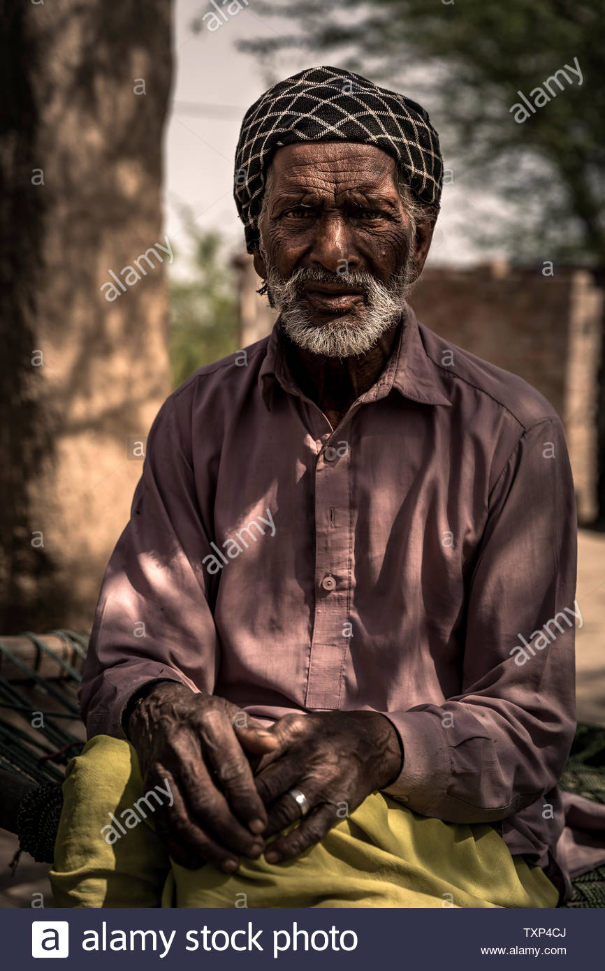 Father and brothers of Christin Asia Bibi, who was sentenced to death for blasphemy but emigrated to Canada, live completely impoverished near Lahore Pakistan. The family of Asia Bibi is also threatened with death and now lives hidden in a small village. - Stock Image