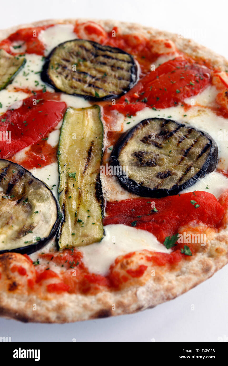 Delicious Pizza with fresh tomato, Buffalo Mozzarella, with grilled Eggplant, and Zucchini on a white background. Stock Photo
