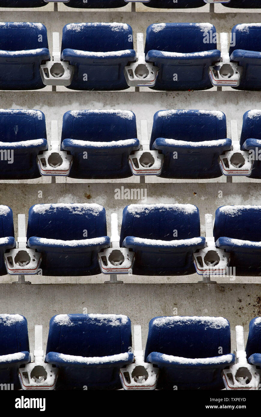 Snow begins to accumulate on the seats in the 200 level section of Gillette Stadium, as snow and light rain fall, before the gates open to let fans into the Stadium for the AFC Championship Game, between the New England Patriots and Indianapolis Colts, Sunday, January 18, 2004, Foxboro, Mass, USA.  (UPI Photo / Steven E. Frischling) - Stock Image