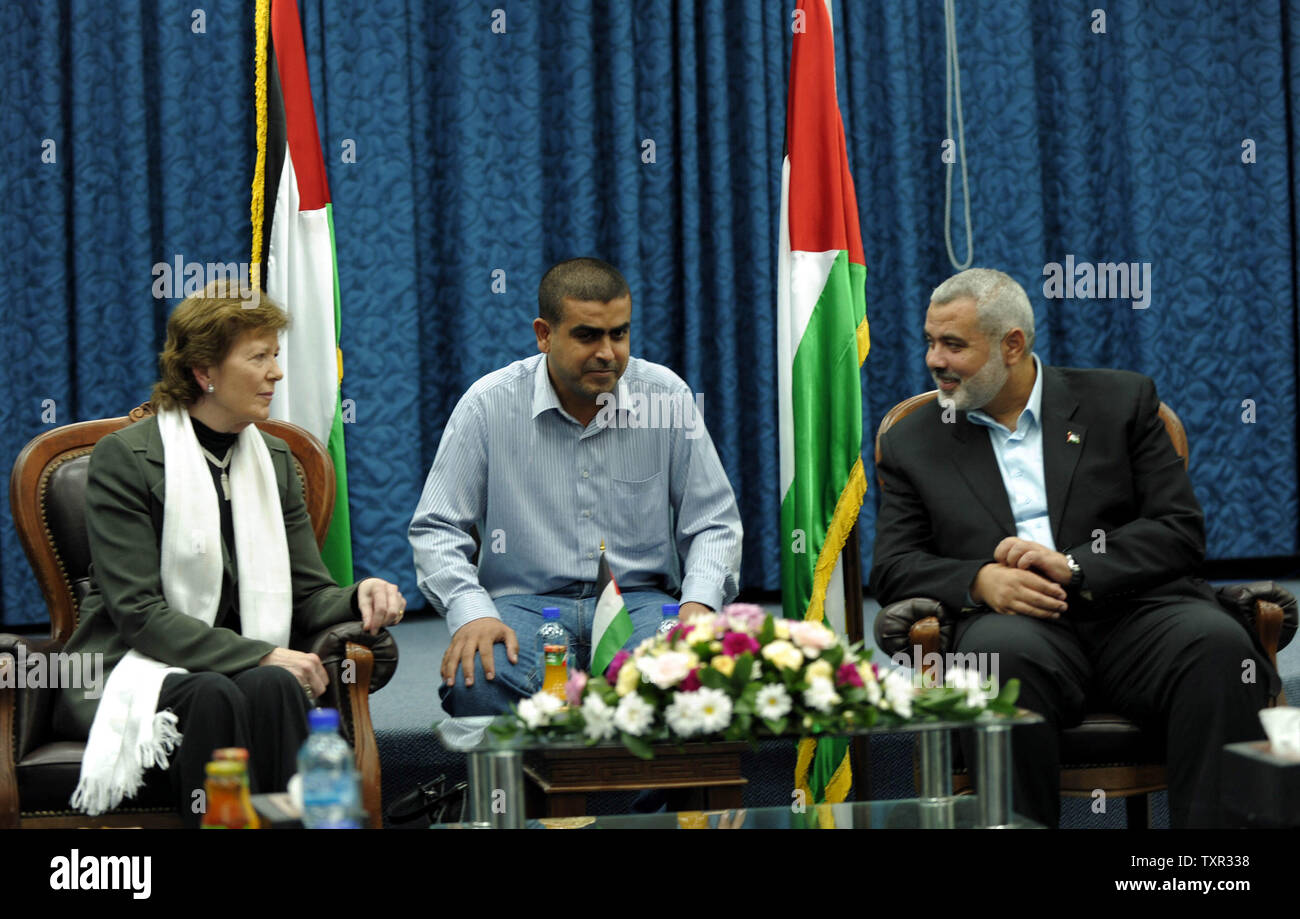 Palestinian Hamas leader Ismail Haniya (R) meets with delegates of The Elders group of retired prominent world figures, former Irish president Mary Robinson (L), Indian activist Ela Bhatt (unseen) and former UN envoy Lakhdar Brahimi (unseen), in Gaza City on October 16, 2010 during the group's visit to the Hamas-run Palestinian territory. UPI/Muhammad Alostaz/Prime Minister's office - Stock Image