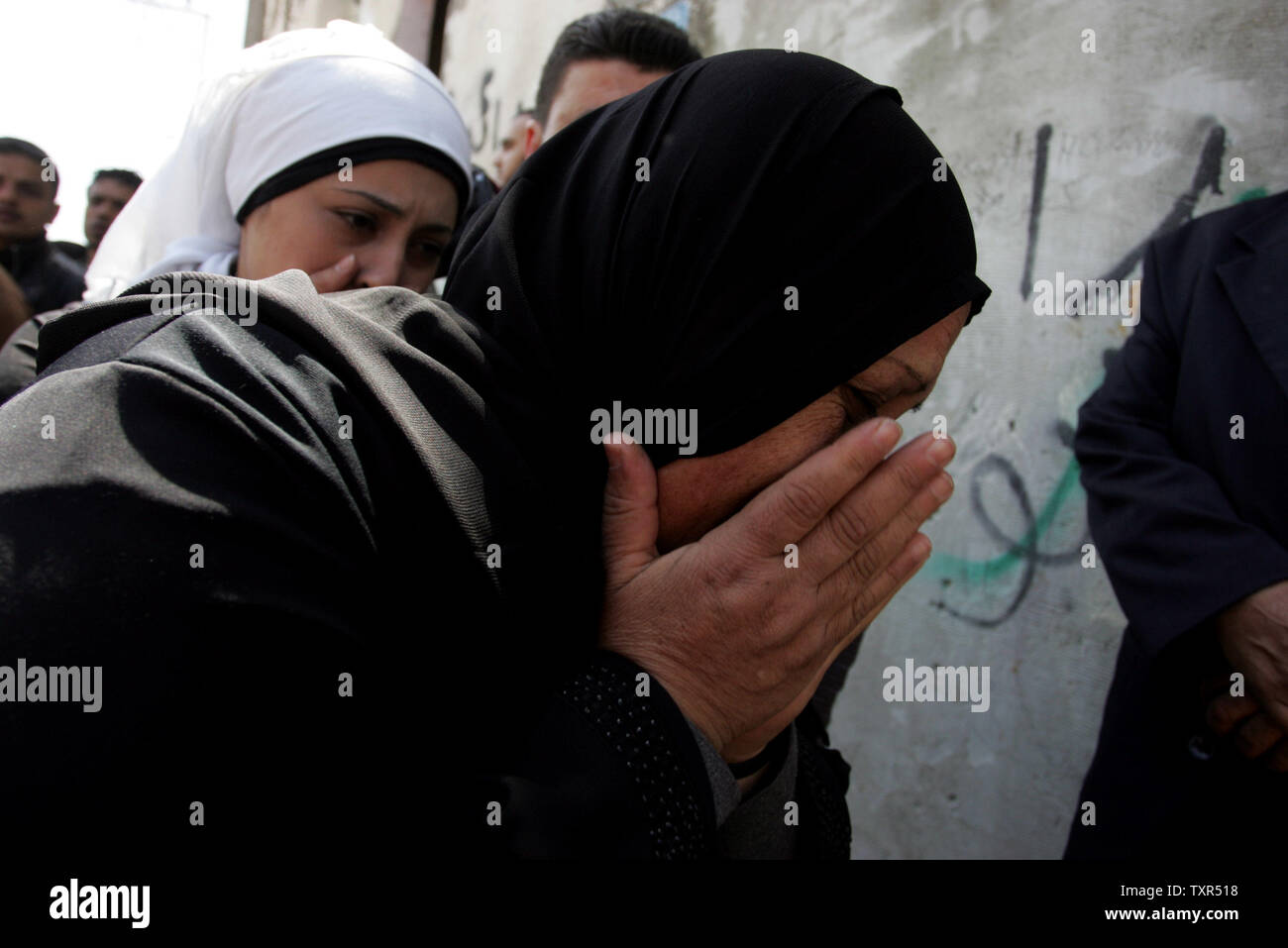 Palestinian women mourn the death of a relative, one of