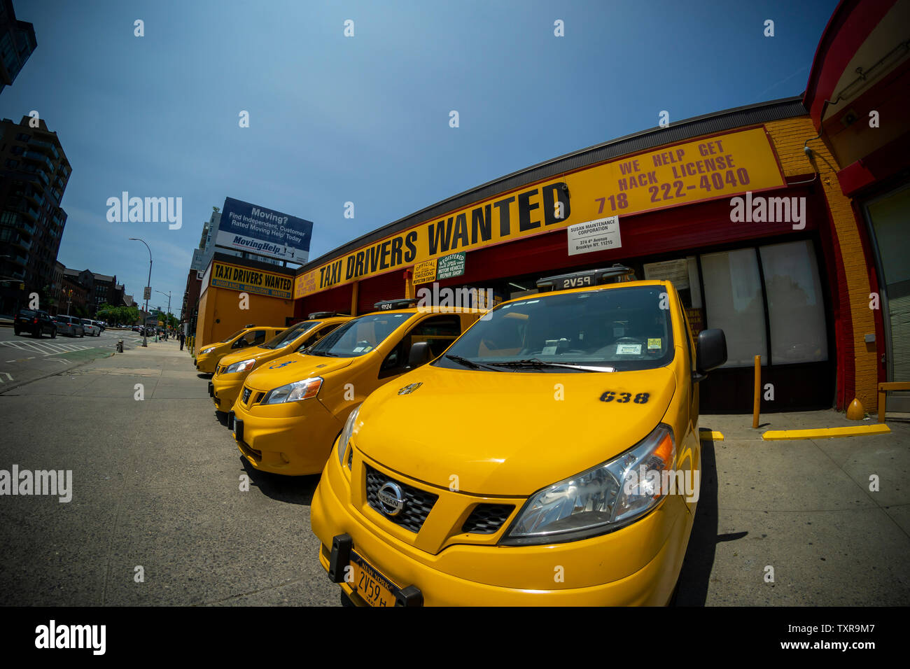 Unused taxis, without drivers, in a taxicab garage in the Park Slope neighborhood of Brooklyn in New York on Sunday, June 23, 2019. With the growth of ride sharing apps such as Lyft and Uber people are abandoning taxis as their preferred form of transportation causing the inflated prices of medallions to plummet. (© Richard B. Levine) - Stock Image