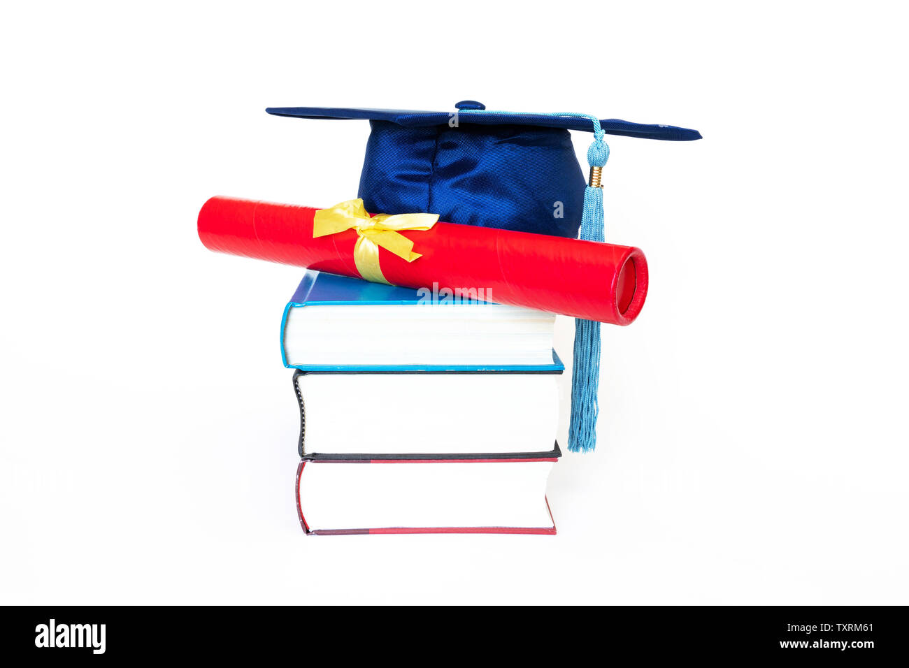 Blue graduation cap with diploma in case on top of books isolated on white background. Education concept. - Stock Image