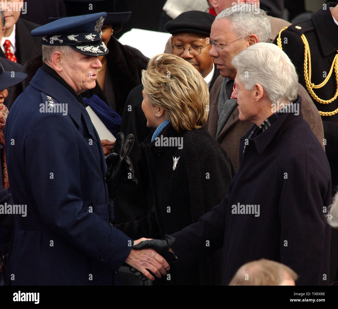 Former President Bill Clinton shakes hands with Chairman of the Joint Chiefs of Staff Richard B. Myers as they arrive for President George W. Bush's second inaugural ceremony on Capitol Hill in Washington on Jan. 20, 2005.   (UPI Photo/Roger L. Wollenberg) - Stock Image
