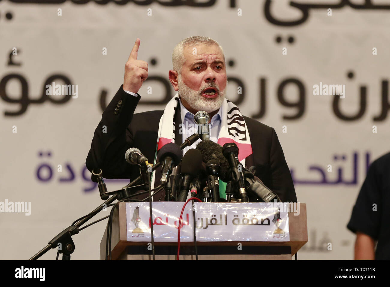 Gaza City, Palestinian Territories. 25th June, 2019. Islamist Hamas movement Chairman Ismail Haniya speaks during a meeting against the US-sponsored conference on Palestinian economic development in Bahrain. The two-day meeting aims at raising 50 billion dollars in investment over 10 years, but Palestinian leaders' refusal to take part is casting serious doubt about the usefulness of the event, called Peace to Prosperity Workshop. Credit: Mohammed Talatene/dpa/Alamy Live News - Stock Image