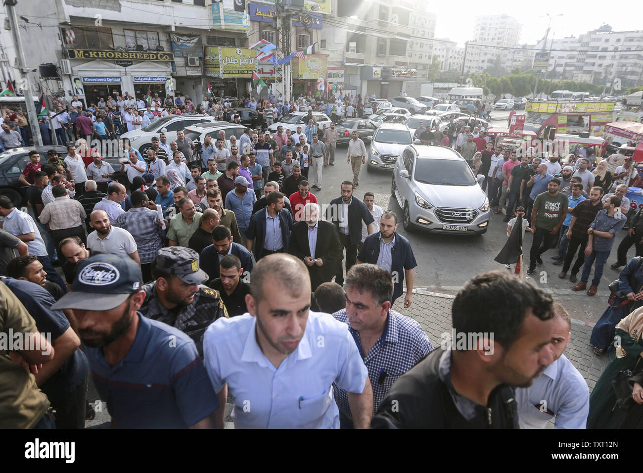 Gaza City, Palestinian Territories. 25th June, 2019. Islamist Hamas movement Chairman Ismail Haniya (C) arrives to attend a meeting against the US-sponsored conference on Palestinian economic development in Bahrain. The two-day meeting aims at raising 50 billion dollars in investment over 10 years, but Palestinian leaders' refusal to take part is casting serious doubt about the usefulness of the event, called Peace to Prosperity Workshop. Credit: Mohammed Talatene/dpa/Alamy Live News - Stock Image