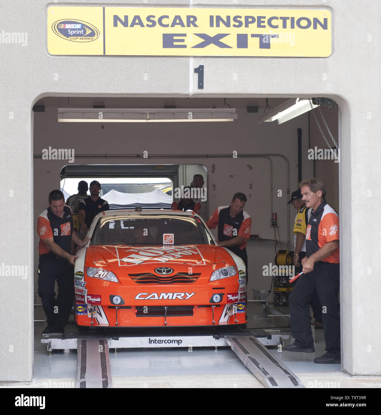 The Crew Of The Home Depot Toyota Pushes Their Car Into Place In