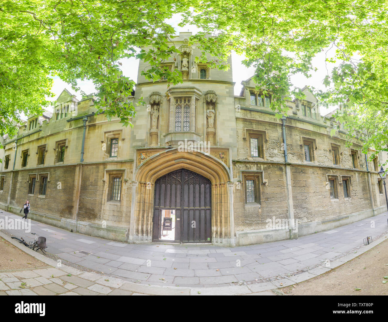 Entrance and exterior facade of St John's college, Oxford university, along St Giles street on a sunny summer morning. - Stock Image