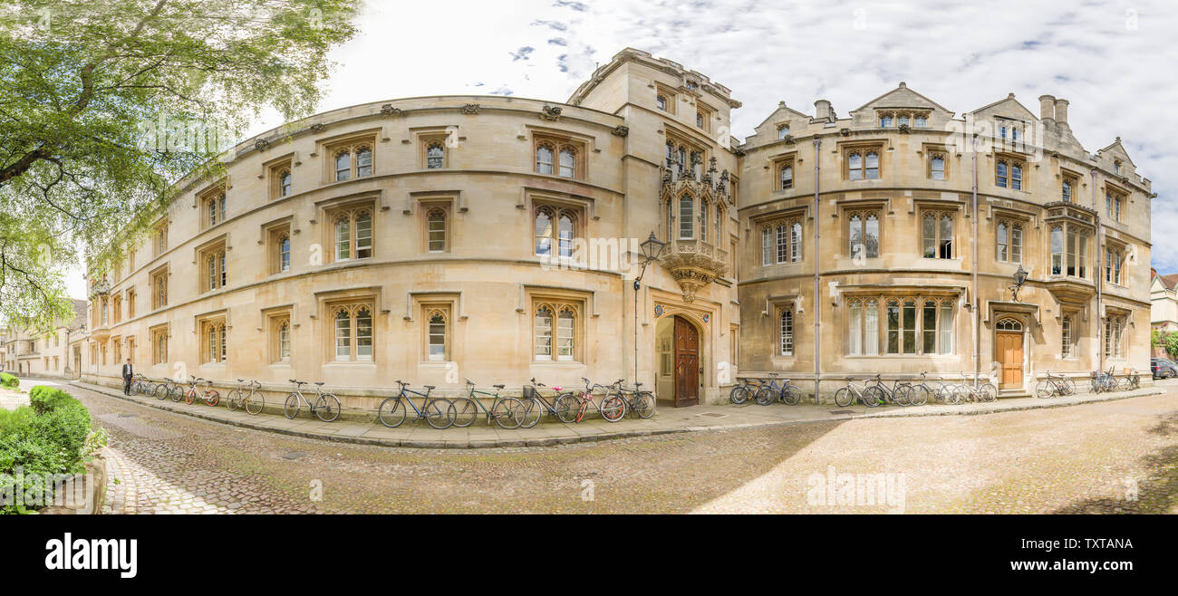 Main entrance and exterior facade of Pembroke college, Oxford university, along the cobbled Prembroke Square and opposite St Aldate's church, on a sun - Stock Image