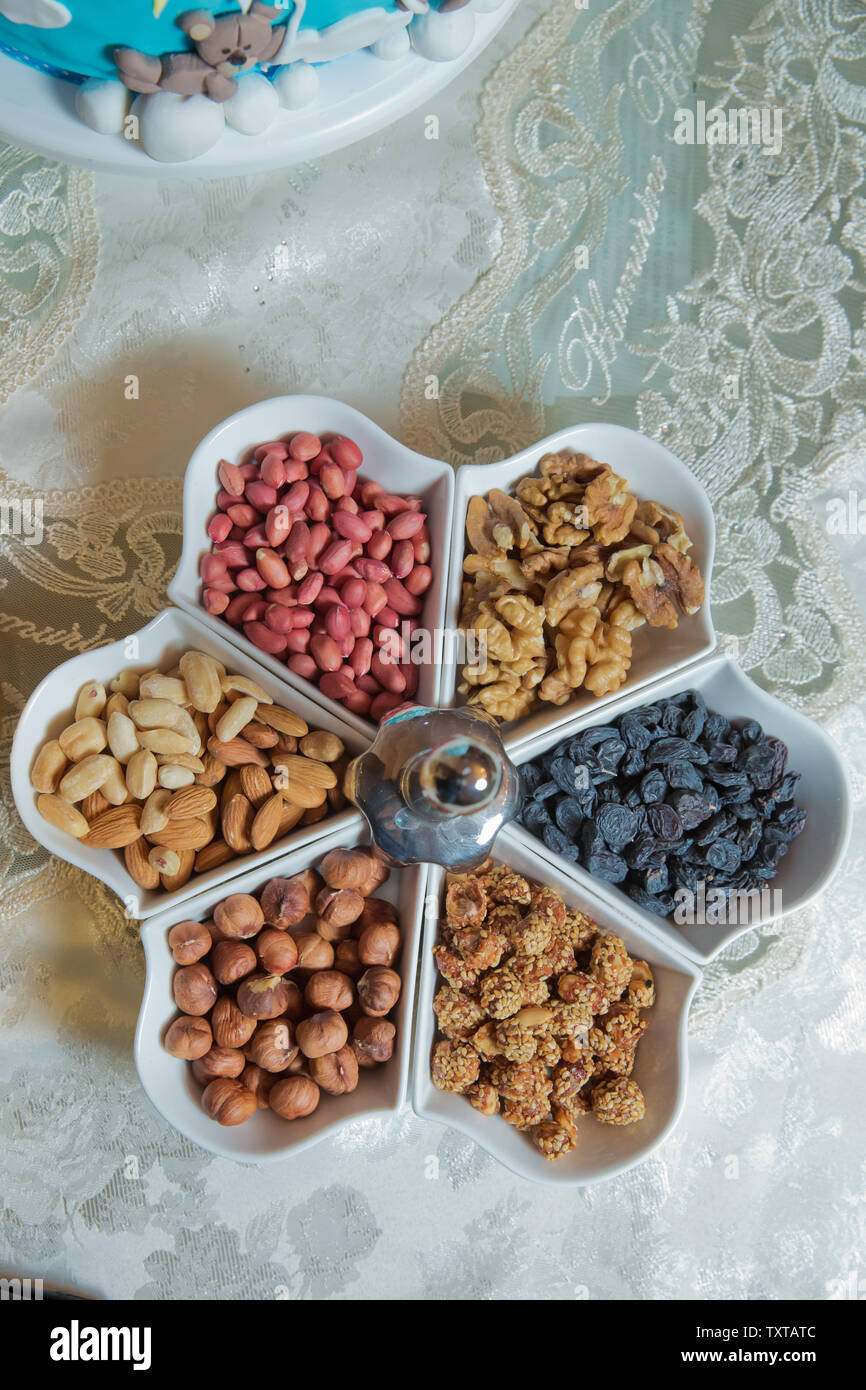 The almond, nuts, arachis, raisins, nuts and walnuts are in the bowl. Mixed desserts Stock Photo