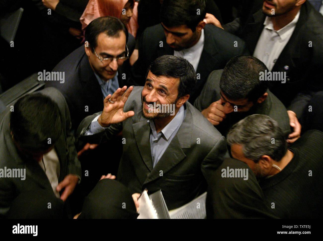Iran's President Mahmoud Ahmadinejad (C) waves after his speech