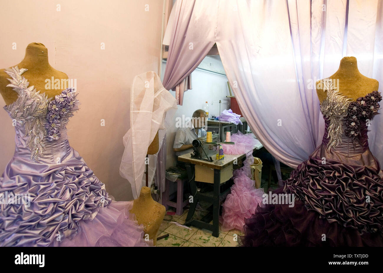 An Iranian Man Sews Wedding Dresses In A Shop In Downtown Tehran