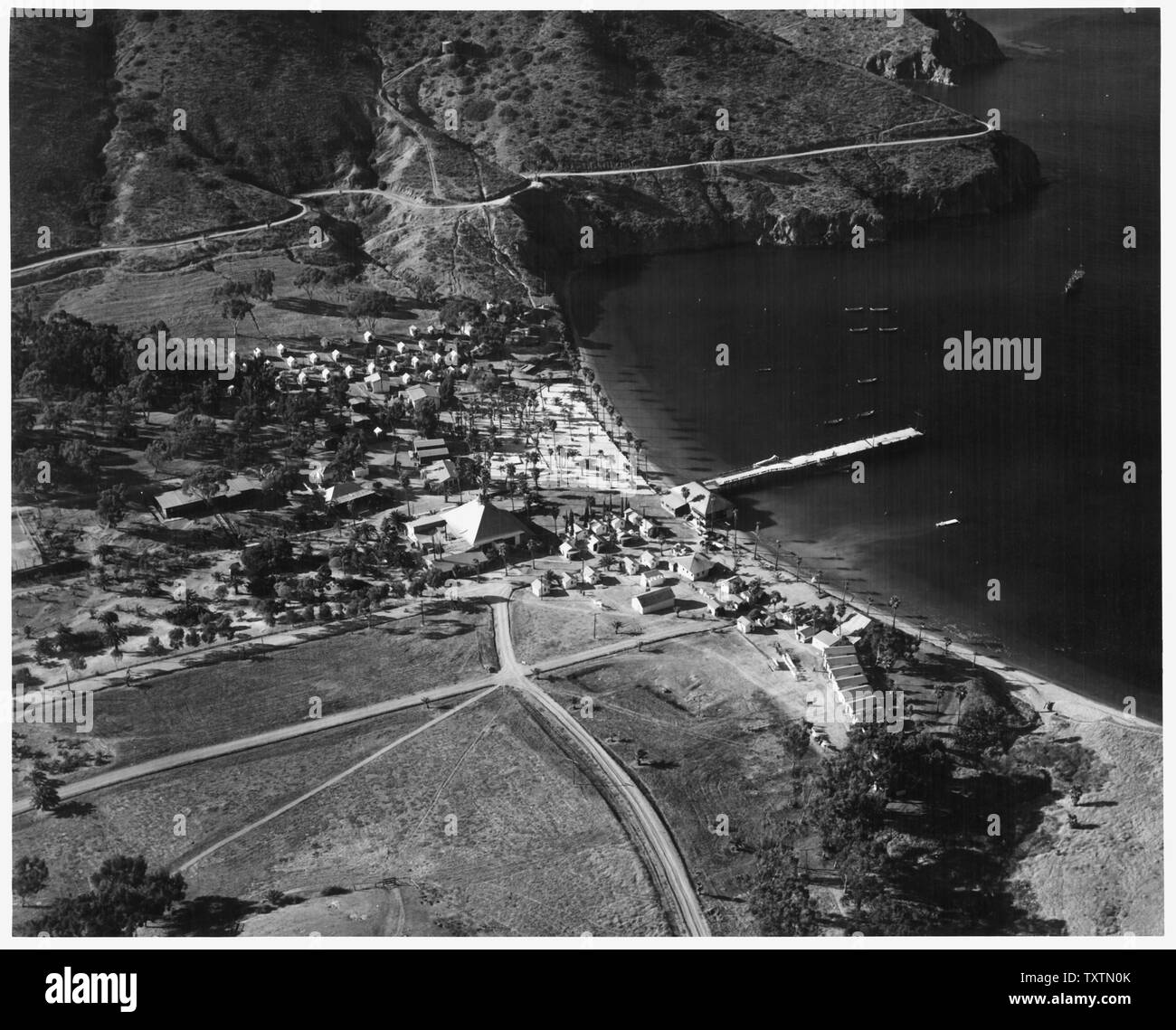 [Aerial view of structures comprising Naval/Coast Guard base at the Isthmus of Catalina Island. Largest building with cupola in foreground is the former Catalina Island Yacht Club.] - Stock Image