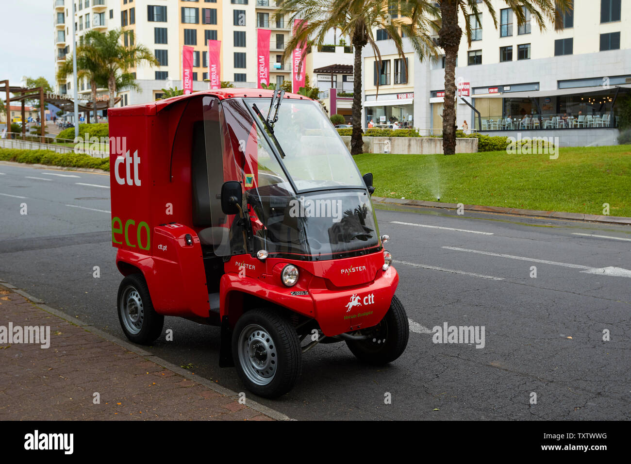Red environmentally friendly Eco-vehicle used by postal service in Funchal, Madeira, Portugal, European Union - Stock Image