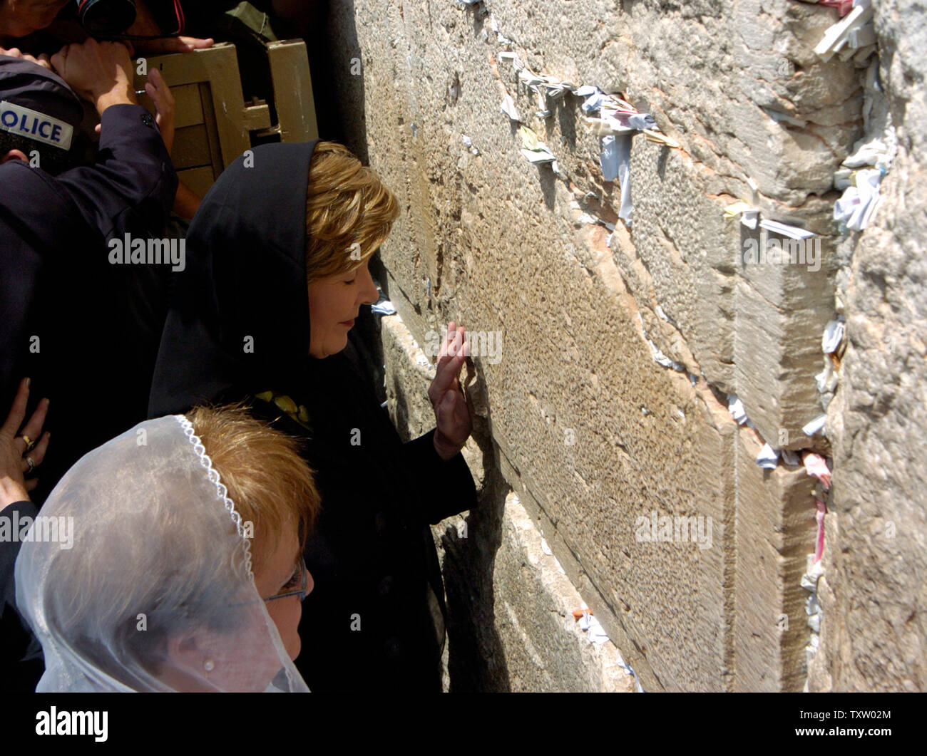 Israeli First Lady Gila Katsav stands beside US First Lady Laura Bush while she prays at  the Western Wall, Judaism's holiest site, in the Old City of Jerusalem, May 22, 2005. Mrs. Bush is visiting Israel as part of a six day tour in the region, aimed at advancing women's rights in the Middle East. (UPI Photo/Debbie Hill) - Stock Image