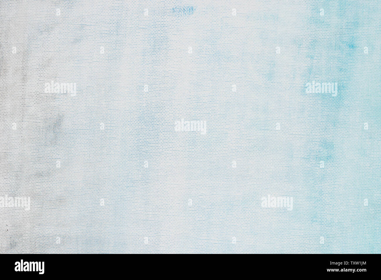 blue and white painted on artistic canvas background texture closeup - Stock Image