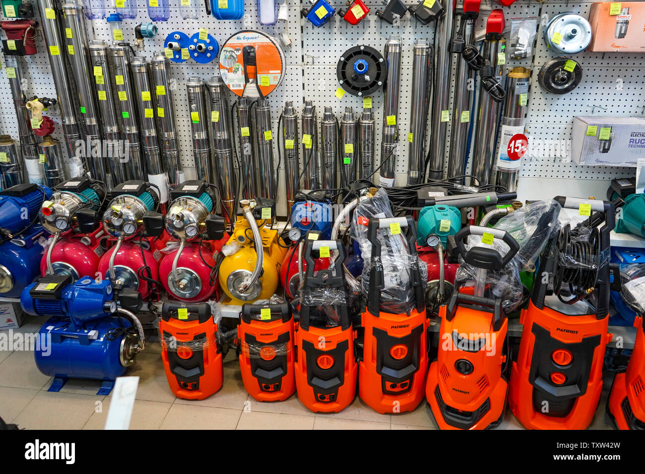 Chelyabinsk Region, Russia - JUNE 2019. Plumbing shop. Rack with goods. Compressors and water pumps. Submersible pumps. Big choice. Stock Photo