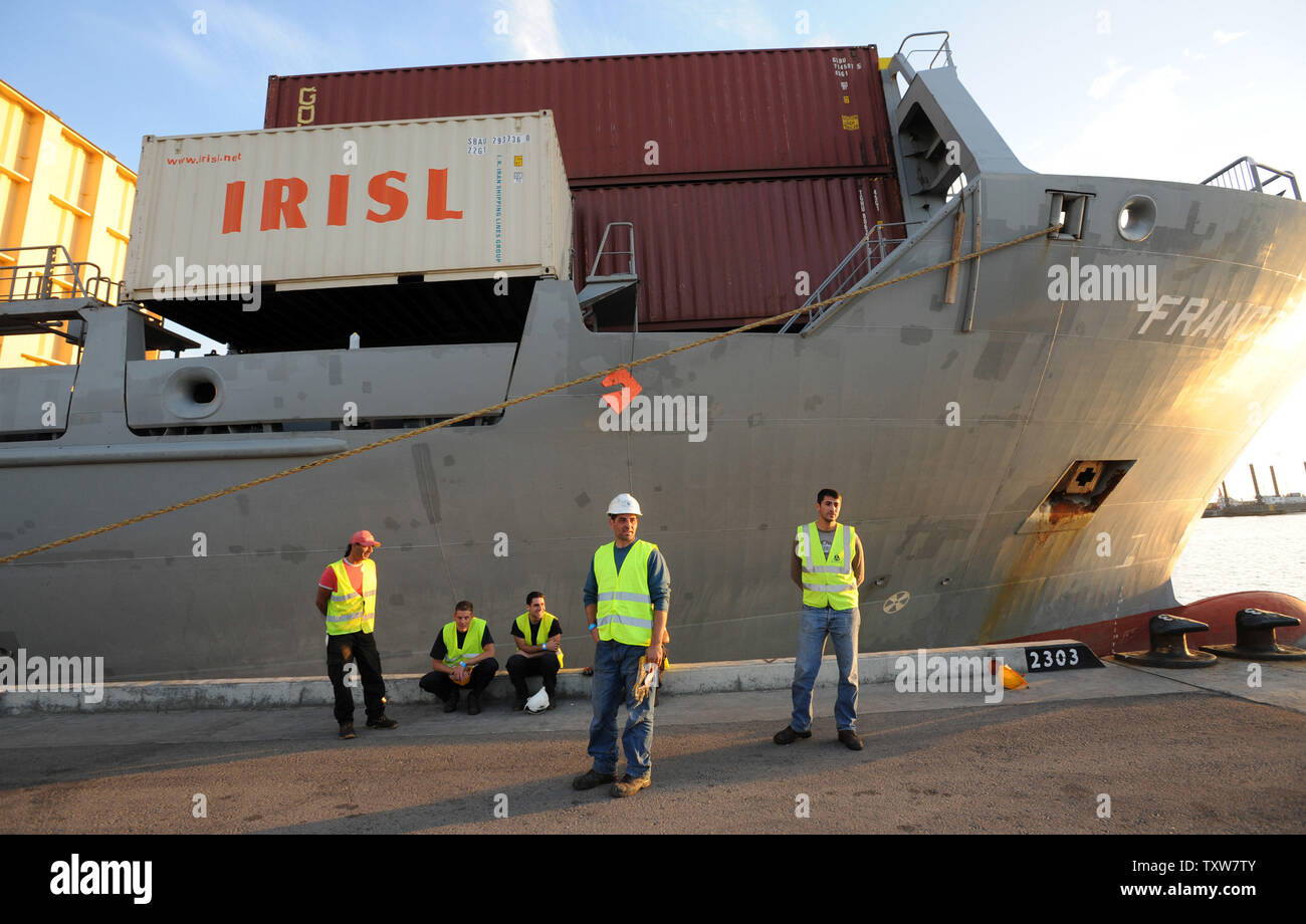 Israeli port workers stand beside the Antiqua-flagged Francop vessel at the Ashdod Port on November 4, 2009. The ship was seized by Israeli commandos in the Mediterranean Sea carrying hundreds of tons of Iranian supplied arms bound for Syria. UPI/Debbie Hill Stock Photo