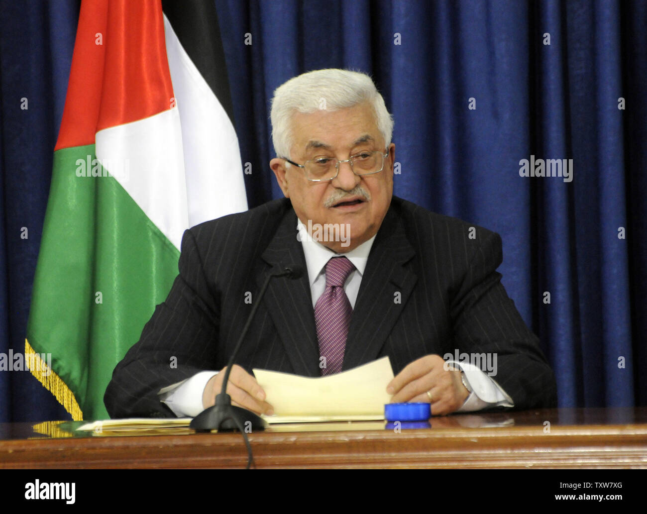 Palestinian President Mahmoud Abbas announces his decision not to seek reelection in the January elections during a speech in Ramallah, West Bank, November 5, 2009.  President Abbas cited disappointment with the US policy on Israeli settlements as one of the factors that led to his decision.  UPI/Debbie Hill - Stock Image