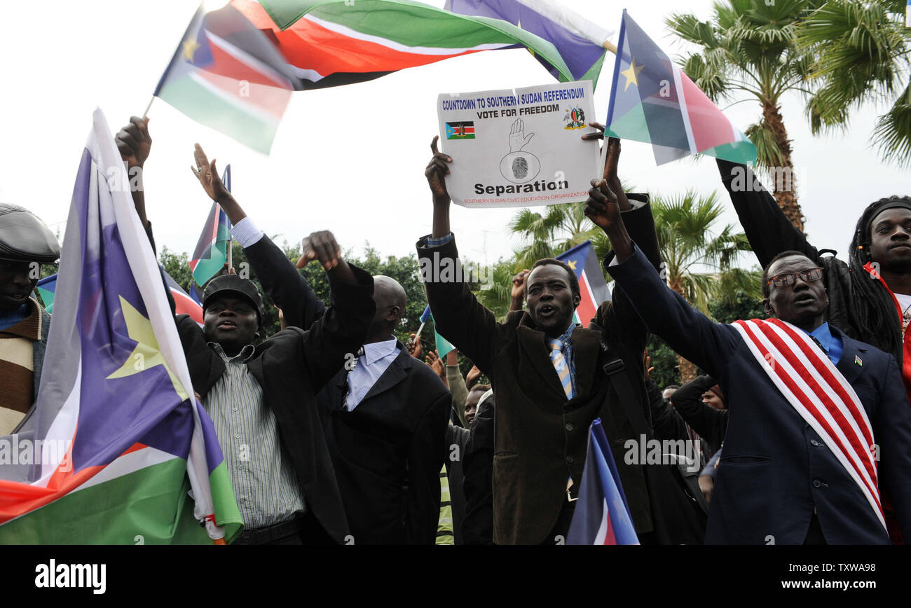 South Sudanese refugees wave South Sudan flags at a rally in Tel Aviv, Israel, to support the Southern Sudan referendum, January 9, 2011. More than a million Southern Sudanese started casting their ballots in the seven day referendum that would split Christian South Sudan from the northern government dominated by Arab Muslims. The referendum is expected to split Africa's largest nation into two, giving birth to the world's newest nation. UPI/Debbie Hill - Stock Image