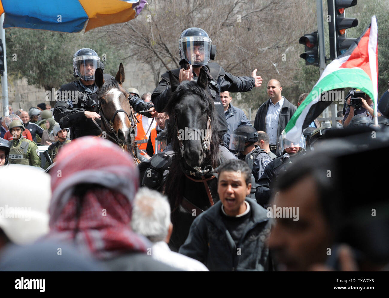 Israeli mounted riot police disperse Palestinians protesters during a demonstration marking Land Day  near the Damascus Gate in East Jerusalem, March 30, 2012. Palestinians chanted slogans against the Israeli occupation and the continued confiscation of Palestinian land.  UPI/Debbie Hill - Stock Image