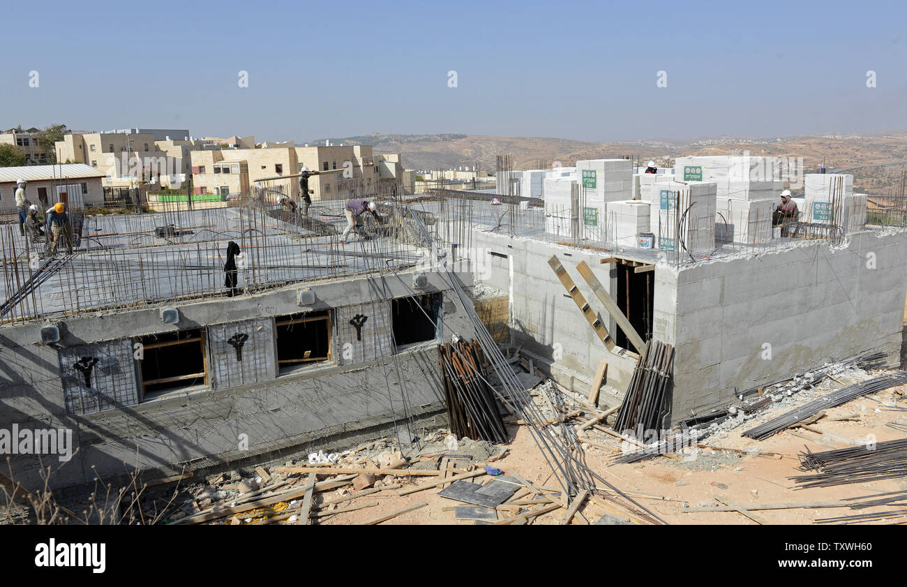Palestinian workers construct new Jewish housing units in