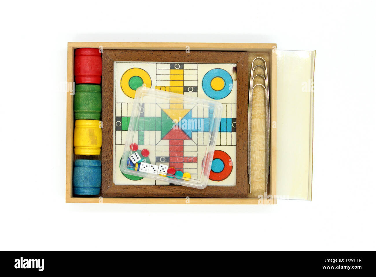 Ludo (board game) miniature,  isolated on white background, close-up Stock Photo