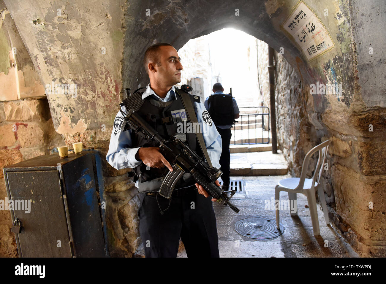 An Israeli police stands guard in the Muslim Quarter of