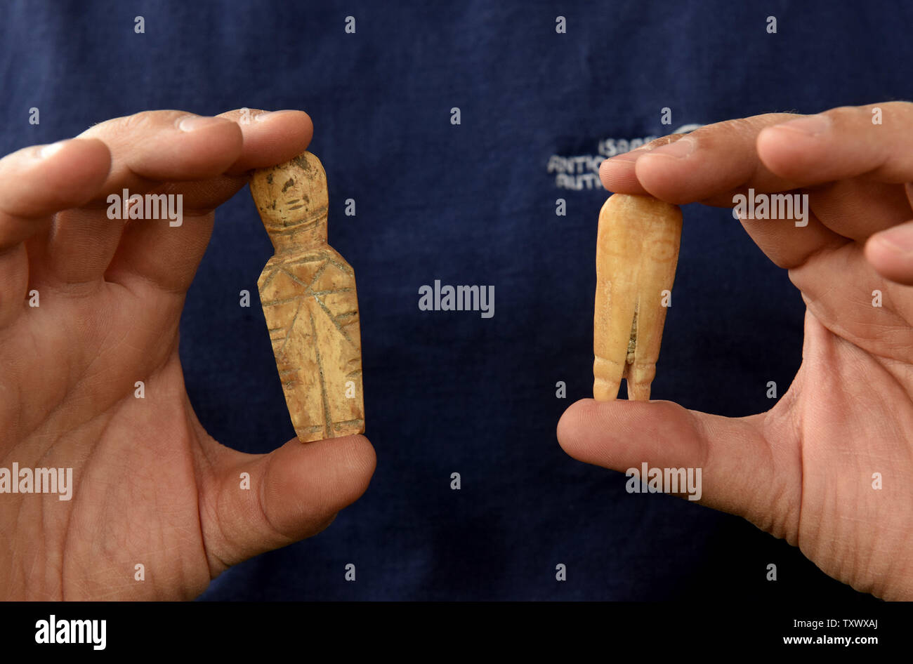 A man holds small puppets made of bone during the Islamic Period that wasdiscovered during excavations by the Israeli Antiquity Authority in Caesarea, Israel, April 26, 2017. The Edmond de Rothschild Foundations is investing approximately $275,000 to expose and restore Caesarea's hidden treasures.  Photo by Debbie Hill/UPI - Stock Image