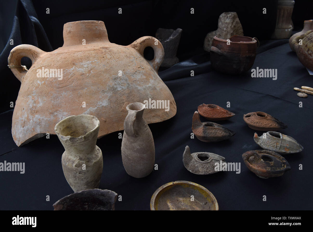 Antiquities that were discovered during excavations by the Israeli Antiquity Authority in Caesarea, are displayed during a press briefing in Caesarea, Israel, April 26, 2017. The Edmond de Rothschild Foundations is investing approximately $275,000 to expose and restore Caesarea's hidden treasures.  Photo by Debbie Hill/UPI - Stock Image
