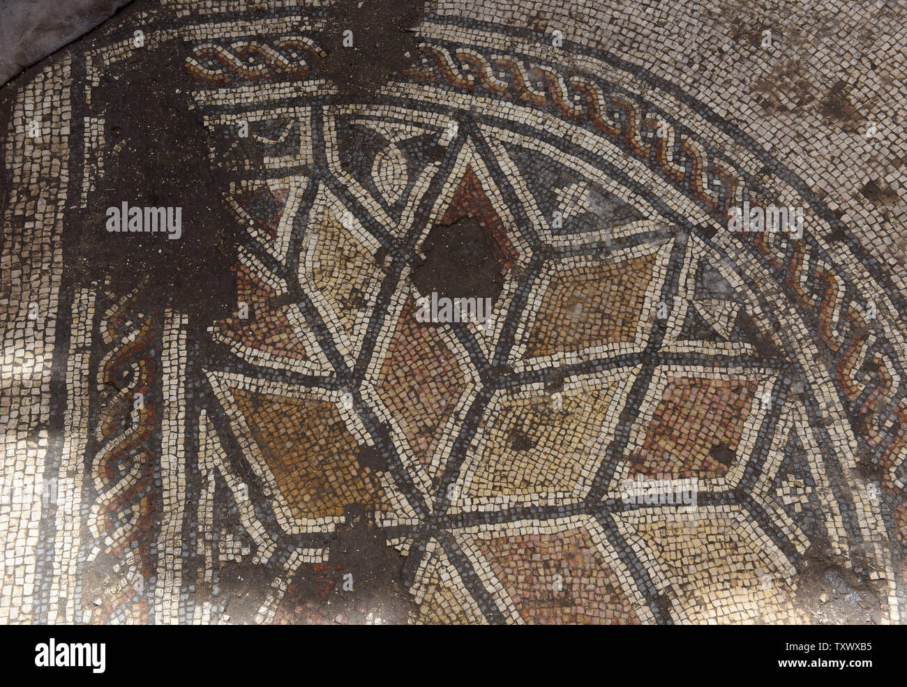 A mosaic is seen in the 'Roma and Augusta Temple' that is being excavated by the Israeli Antiquity Authority in Caesarea, Israel, April 26, 2017. The Temple was constructed in the first century by King Herod in honor of Augustus Caesar. The Edmond de Rothschild Foundations is investing approximately $275,000 to expose and restore Caesarea's hidden treasures.  Photo by Debbie Hill/UPI - Stock Image