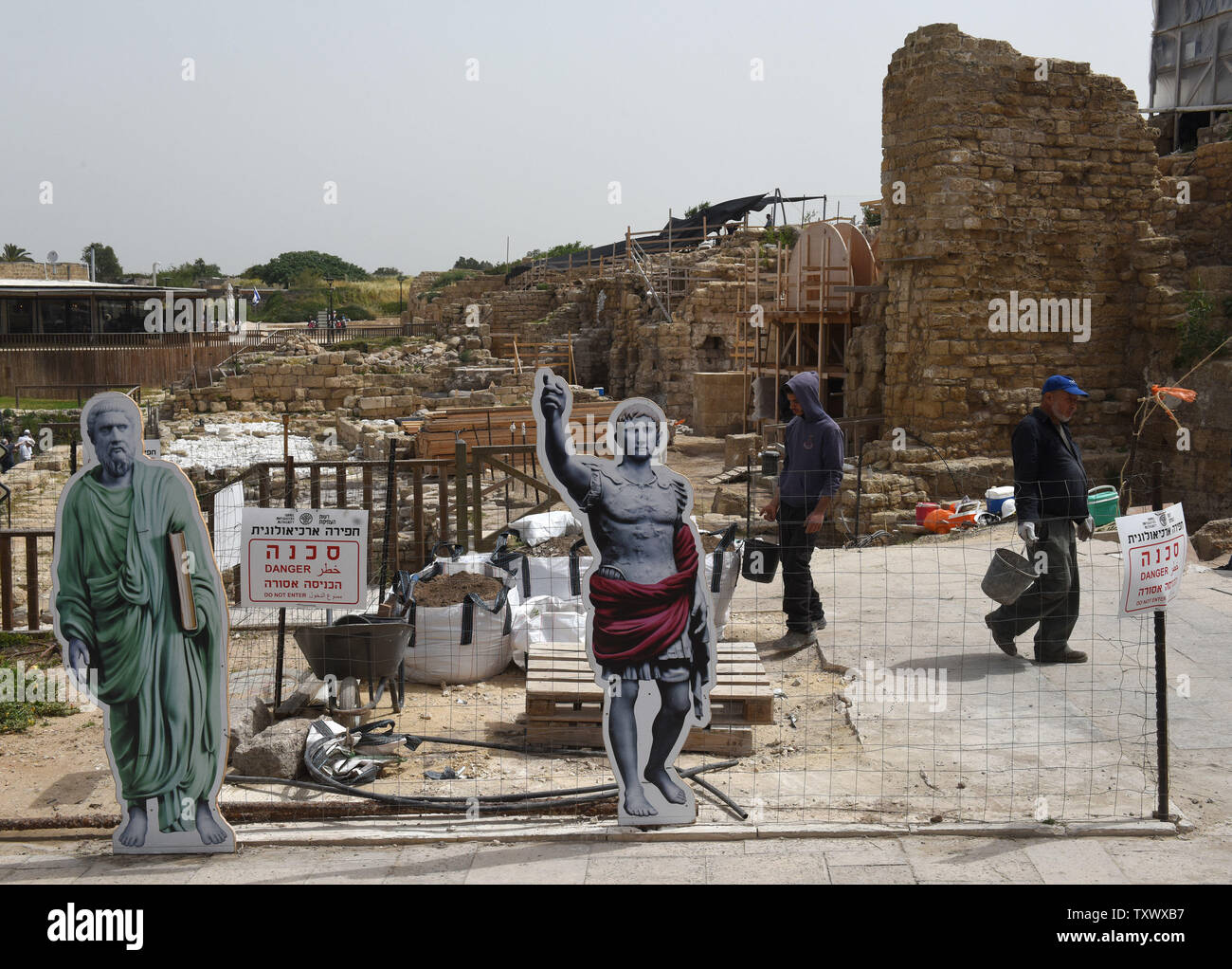 Workers carry buckets of dirt at the 'Roma and Augusta Temple' that is being excavated by the Israeli Antiquity Authority in Caesarea, Israel, April 26, 2017. The Temple was constructed in the first century by King Herod in honor of Augustus Caesar. The Edmond de Rothschild Foundations is investing approximately $275,000 to expose and restore Caesarea's hidden treasures.  Photo by Debbie Hill/UPI - Stock Image