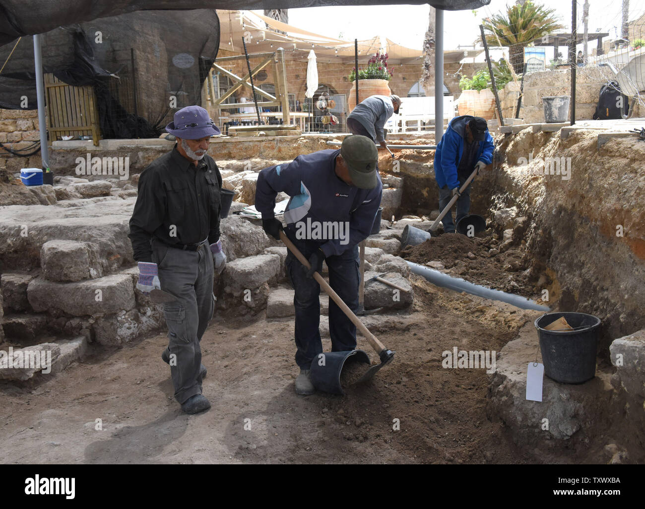 Workers excavate an area of 'Roma and Augusta Temple' that is being excavated by the Israeli Antiquity Authority in Caesarea, Israel, April 26, 2017. The Temple was constructed in the first century by King Herod in honor of Augustus Caesar. The Edmond de Rothschild Foundations is investing approximately $275,000 to expose and restore Caesarea's hidden treasures.  Photo by Debbie Hill/UPI - Stock Image