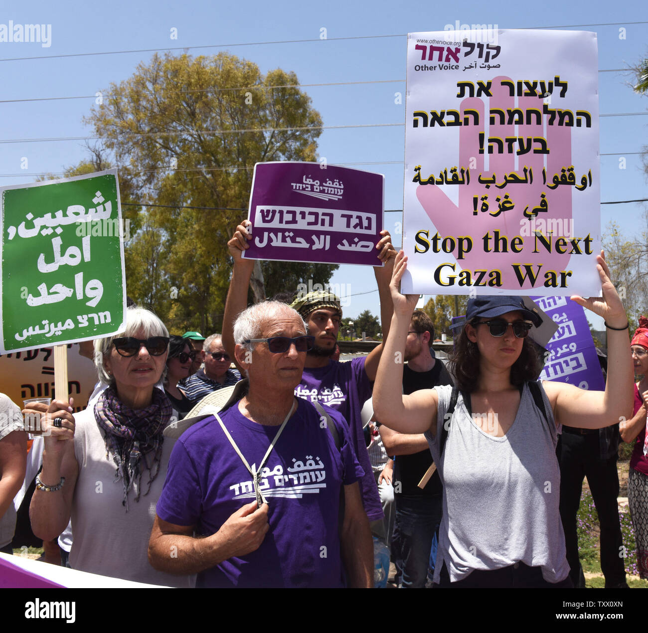 Israeli protesters hold signs calling on the government to stop the bloodshed of Palestinians on the Gaza border at a demonstration at  Yad Mordechai, Israel, near the Gaza Strip, May 18, 2018.  More than a hundred Palestinians have been killed by the Israeli army in protests along the Israel-Gaza border in recent weeks.   Photo by Debbie Hill/UPI - Stock Image