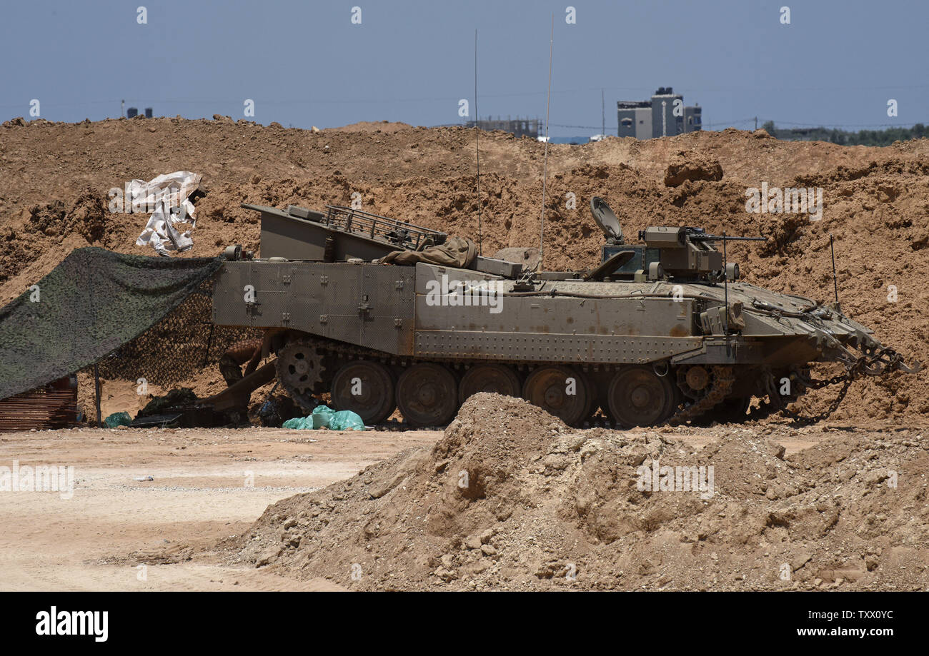 An Israeli armored personnel carrier is seen along the the Israeli- Gaza border, near Kibbutz Nahal Oz, June 5, 2018. Over 600 kites have been flown into Israel from the Gaza Strip, destroying 9000 square meters of crops and forests.    Photo by Debbie Hill/UPI - Stock Image