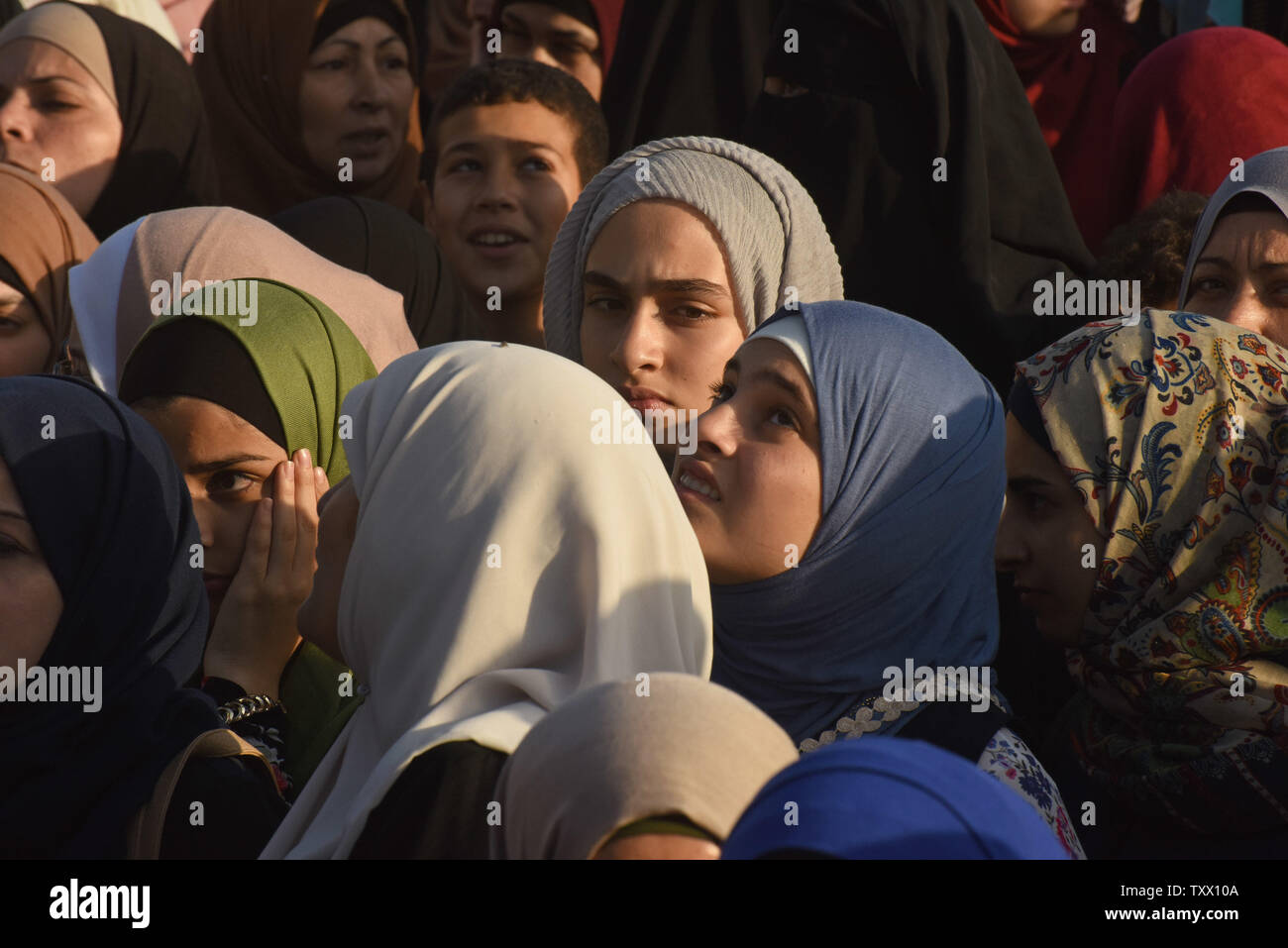 Palestinians wait in line to pass Israeli security forces before crossing the Qalandiya checkpoint, West Bank, from Ramallah to Jerusalem, to pray at the Al-Aqsa Mosque on the last Friday of the Muslim holy month of Ramadan, June 8, 2018.  Photo by Debbie Hill/UPI - Stock Image
