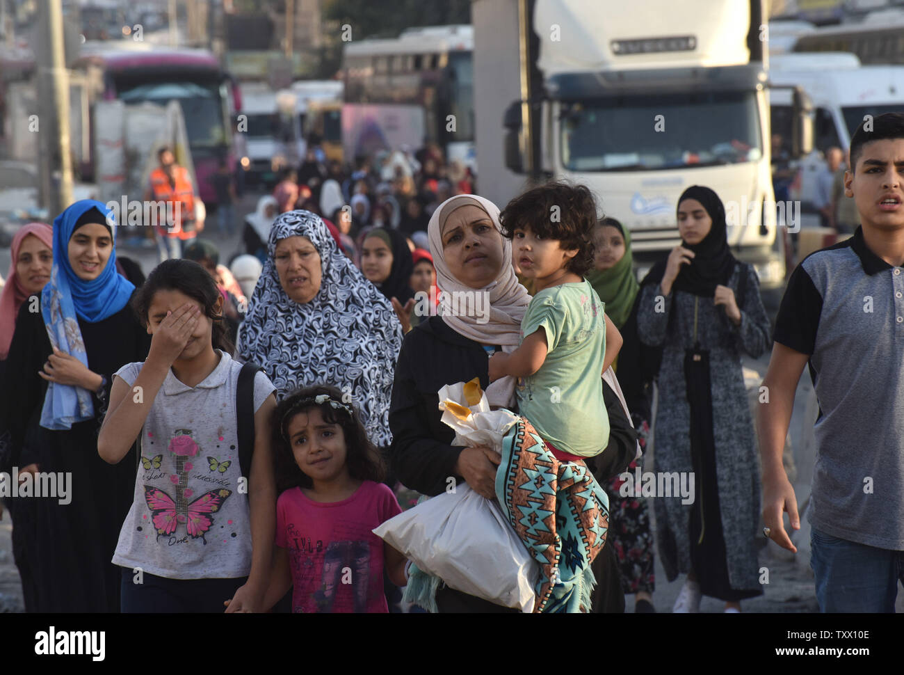 Palestinians walk to the Qalandiya checkpoint, West Bank, from Ramallah to Jerusalem, to pray at the Al-Aqsa Mosque on the last Friday of the Muslim holy month of Ramadan, June 8, 2018.  Photo by Debbie Hill/UPI - Stock Image