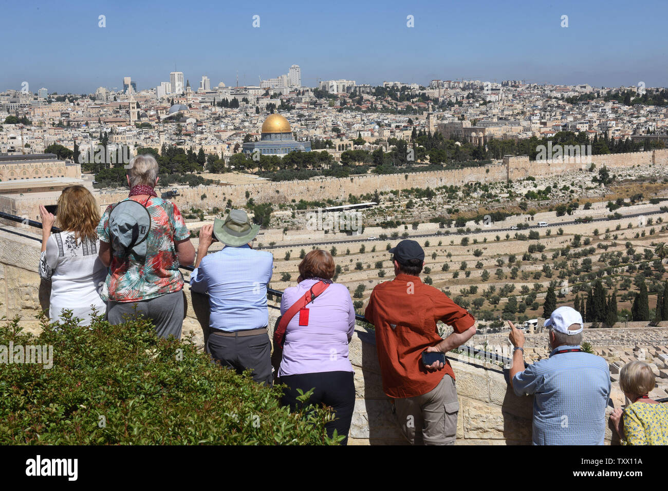 Tourists look at the Old City of Jerusalem from the Mt. of Olives, in East Jerusalem, June 25, 2018. Prince William will  receive a briefing on the history and geography of Jerusalem's Old City from the Mt. of Olives this week, on the first state visit to the Holy Land by a member of the royal family. Israeli ministers slammed Prince William's official itinerary because it describes the Old City of Jerusalem as being in Occupied Palestinian Territories.  Photo by Debbie Hill/UPI - Stock Image