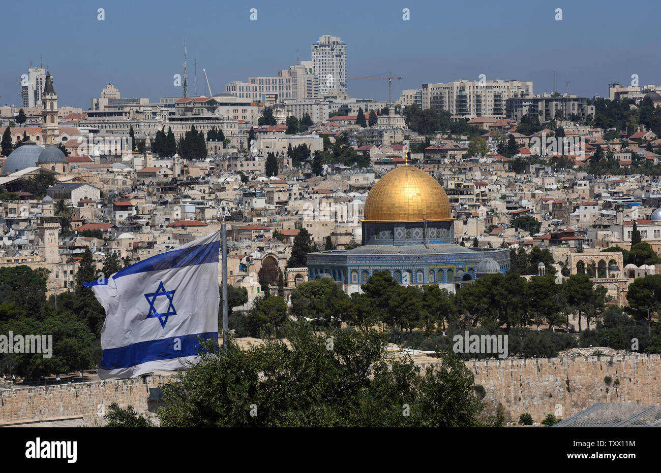 An Israeli flag flies on Mt. of Olives, overlooking the Old City of Jerusalem, June 25, 2018. Prince William will  receive a briefing on the history and geography of Jerusalem's Old City from the Mt. of Olives this week, on the first state visit to the Holy Land by a member of the royal family. Israeli ministers slammed Prince William's official itinerary because it describes the Old City of Jerusalem as being in Occupied Palestinian Territories.  Photo by Debbie Hill/UPI - Stock Image