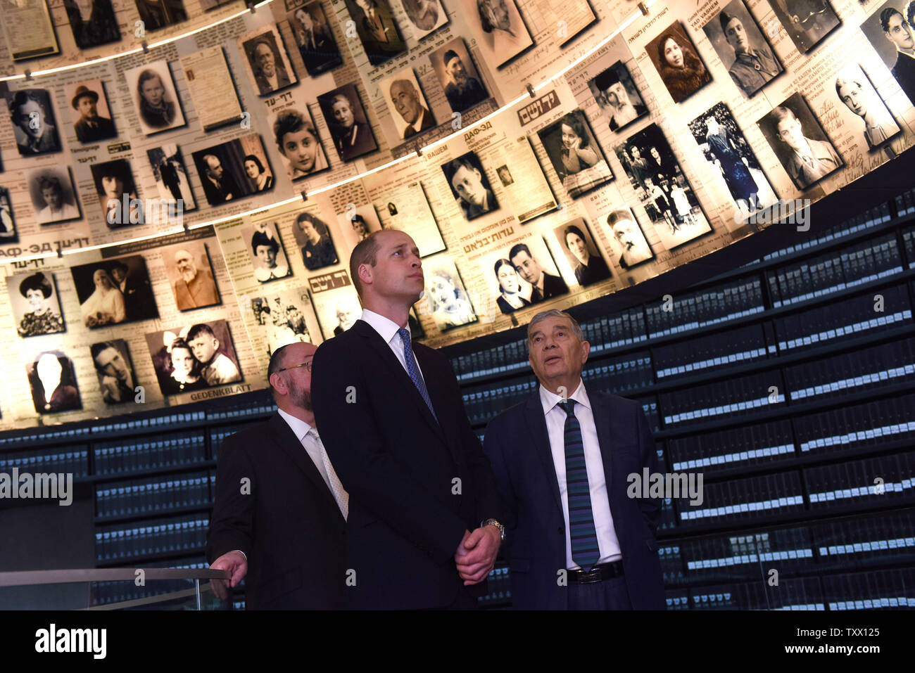 (C)Prince William, the Duke of Cambridge, is joined by (L) Chief Rabbi of the UK, Ephraim Mirvis, and (R) Chairman of Yad Vashem, Avner Shalev, in the Hall of Names in the Yad Vashem, the World Holocaust Remembrance Center, in Jerusalem, Israel, June 26, 2018.  Photo by Debbie Hill/UPI - Stock Image
