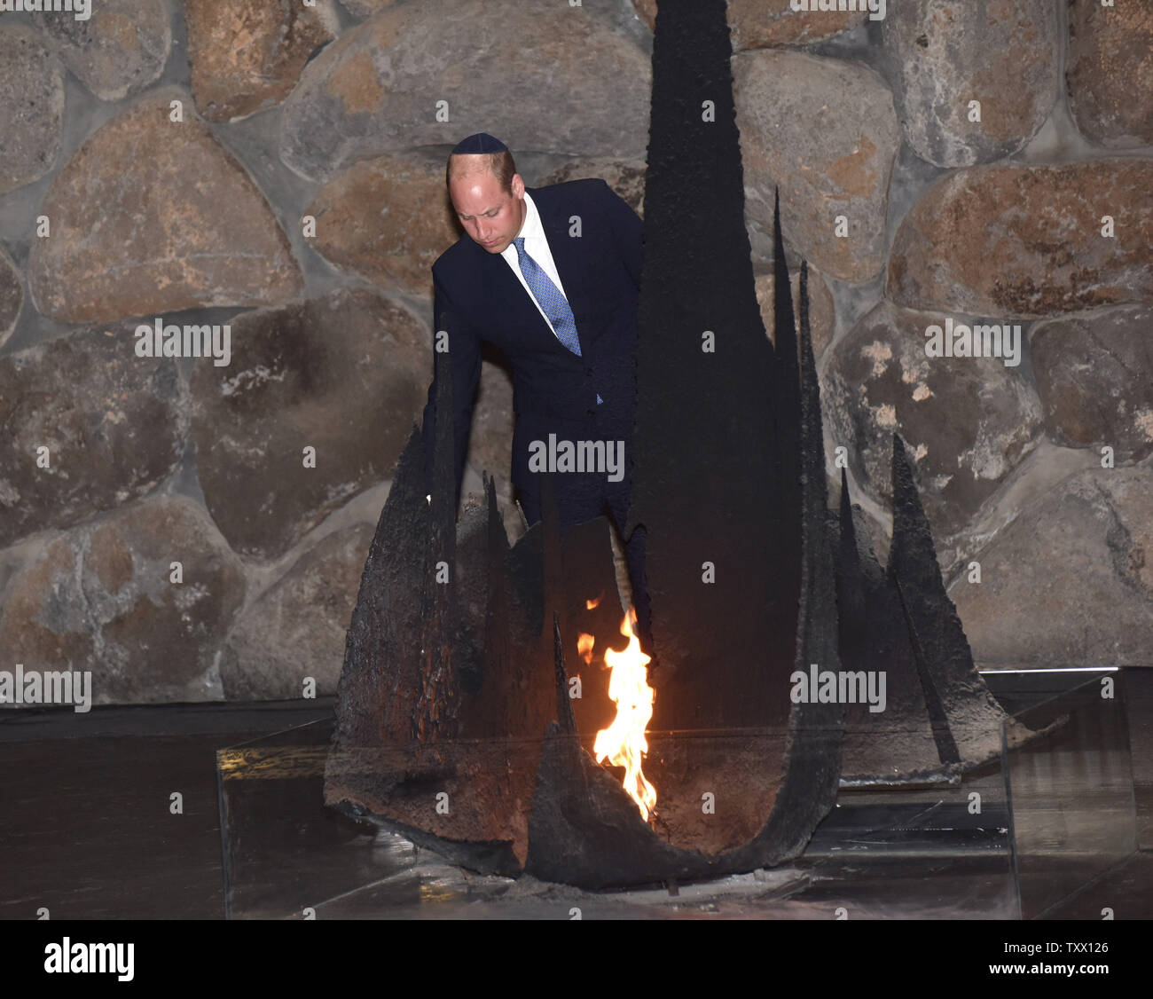 Prince William, the Duke of Cambridge, rekindles the eternal flame during a memorial ceremony  in the Hall of Remembrance at Yad Vashem, the World Holocaust Remembrance Center, in Jerusalem, Israel, June 26, 2018.  Photo by Debbie Hill/UPI - Stock Image