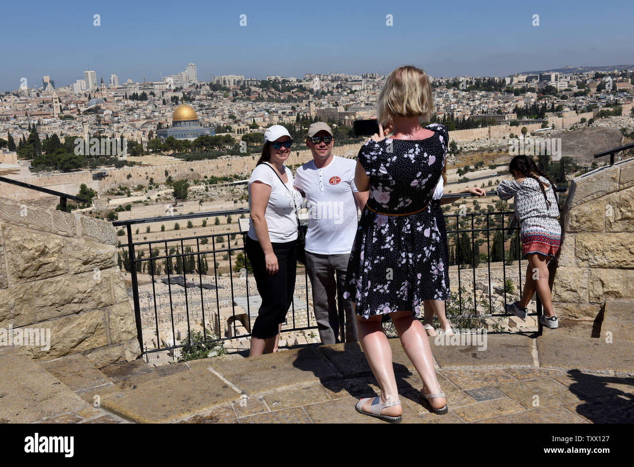Tourists look at the Old City of Jerusalem from the Mt  of