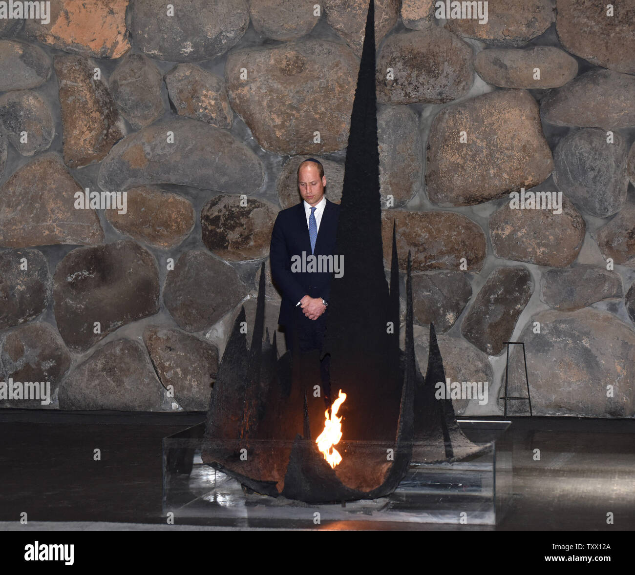 Prince William, the Duke of Cambridge, paues after rekindling the eternal flame during a memorial ceremony in the Hall of Remembrance at Yad Vashem, the World Holocaust Remembrance Center, in Jerusalem, Israel, June 26, 2018.  Photo by Debbie Hill/UPI - Stock Image