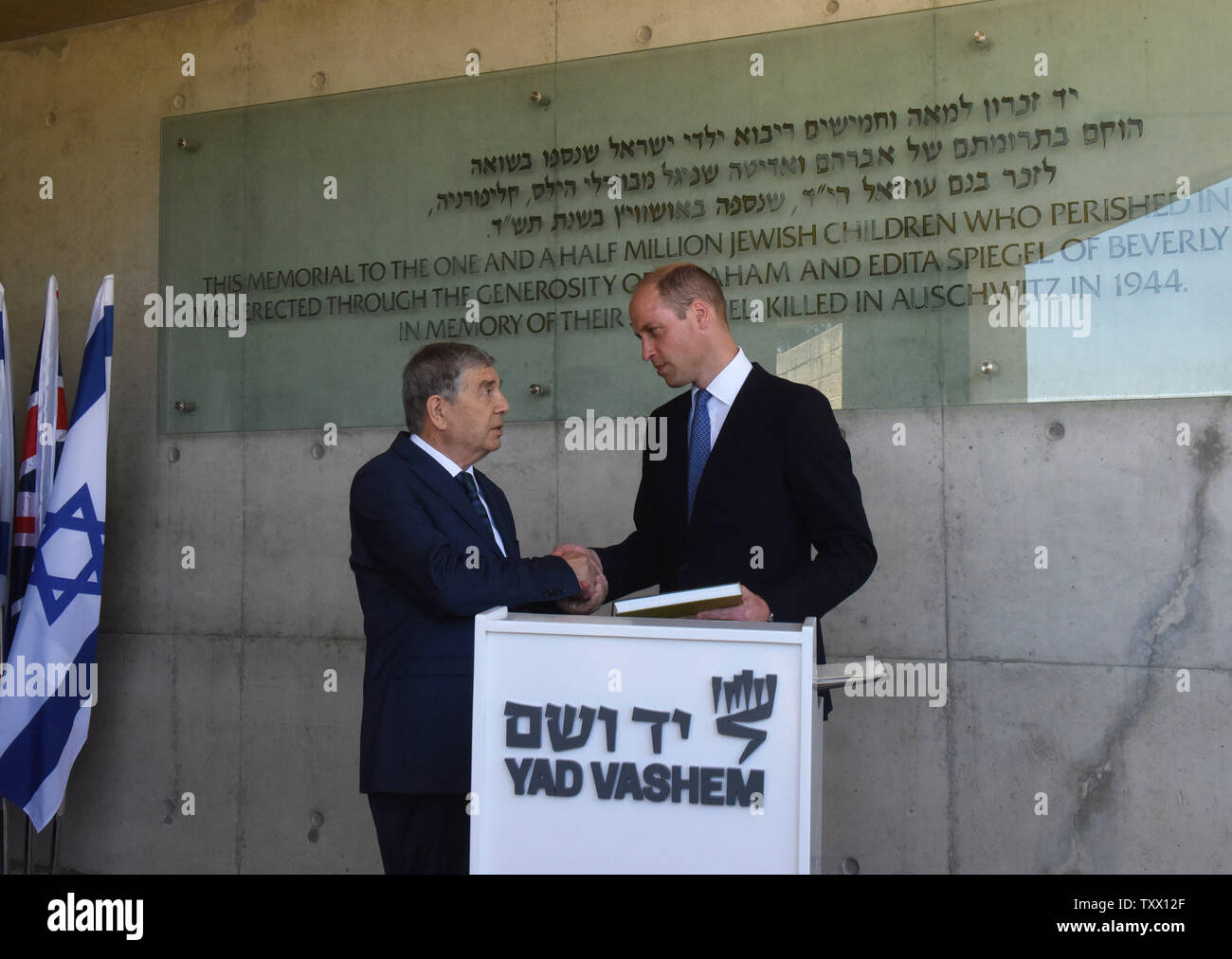 Prince William, the Duke of Cambridge, shake hands with the Chairman of Yad Vashem Avner Shalev, after signing the guest book of Yad Vashem, the World Holocaust Remembrance Center, in Jerusalem, Israel, June 26, 2018.  Photo by Debbie Hill/UPI - Stock Image