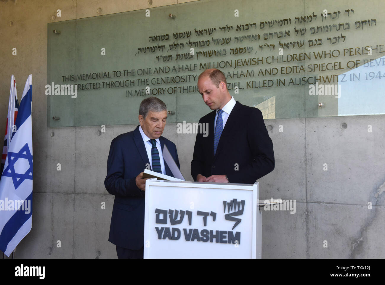 Prince William, the Duke of Cambridge, is given a book by the Chairman of Yad Vashem Avner Shalev, after signing the guest book of Yad Vashem, the World Holocaust Remembrance Center, in Jerusalem, Israel, June 26, 2018.  Photo by Debbie Hill/UPI - Stock Image