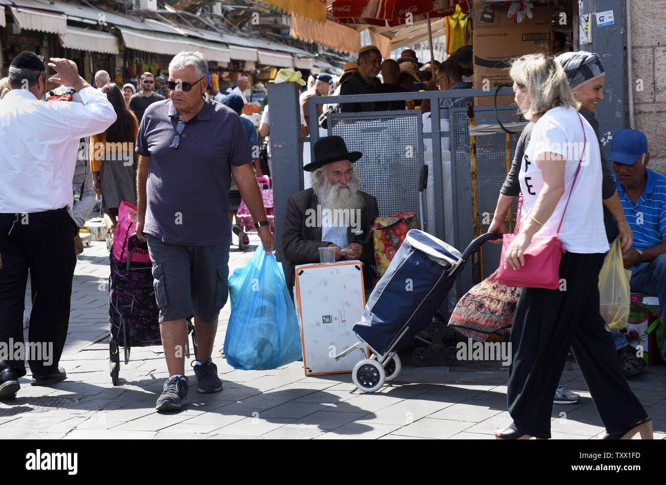 Israeli Jews shop in the Mahane Yehuda Market in Jerusalem, Israel,  September 5, 2018, in preparation for Rosh HaShana, the Jewish New Year, which starts at sundown on Sunday, September 9, 2018. Pomegranates, apples and honey are traditionally eaten during the Jewish High holidays which is the period of repentance in the Jewish calendar. The abundance of seeds in the pomegranate is associated with the 613 commandments in the Torah and serve as symbols of righteousness and fruitfulness.  Photo by Debbie Hill/UPI - Stock Image
