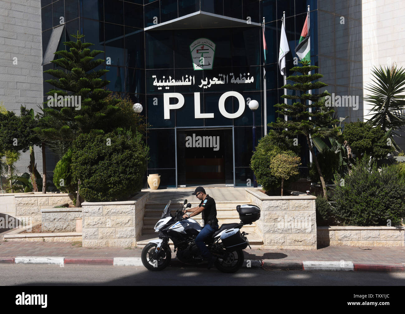 A Palestinian rides a motorcycle outside the PLO, Palestinian Liberation Organization, headquarters in Ramallah, West Bank, September 17, 2018. According to a PLO statement, U.S. authorities told employees of the PLO office in Washington,D.C. to cease operations, close all bank accounts and vacate the premises by Oct. 13. The visas of the Palestinian Ambassador Husam Zomlot and his family were revoked by American authorities who demanded they  leave the country.   Photo by Debbie Hill/UPI Stock Photo