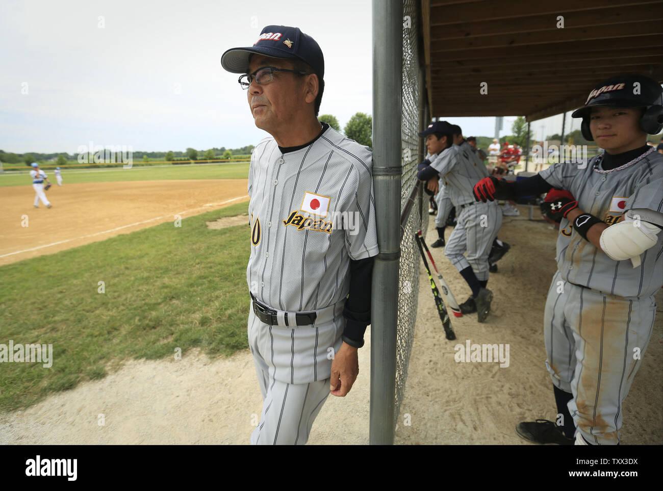 Japan coach Sadao Nakashiro (L) watches from the bench as