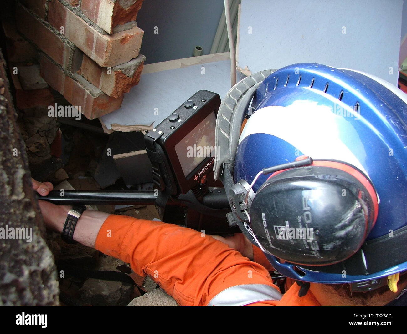 USAR fire fighter with confined space inspection camera - Stock Image