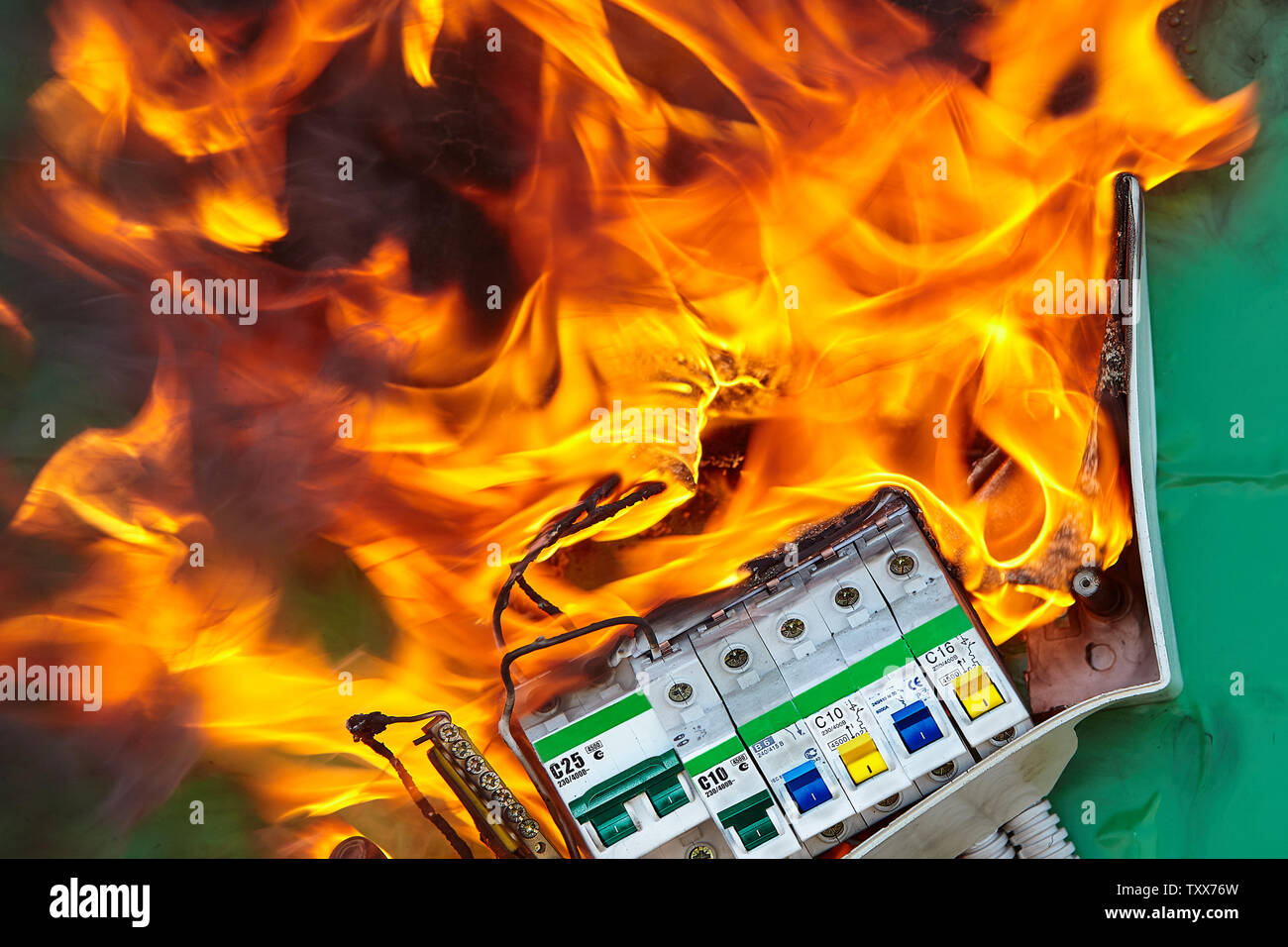 Fire can occur when there are instances of faulty electrical appliances and wiring at home, causing an electrical fire. Stock Photo